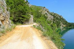 Dirt road by lake royalty free stock photo