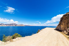 Dirt Road and Lake Titicaca Stock Photos