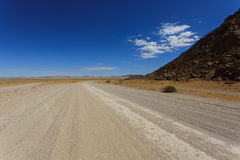 Dirt road. Landscape along a dirt road from Sesriem to Solitaire, Namibia Royalty Free Stock Photo