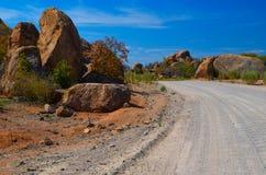 Dirt road through large stones Royalty Free Stock Image