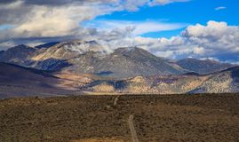 Dirt road leading to eastern sierra mountain range royalty free stock images