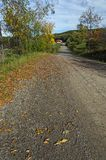 Dirt Road Leading to Hills. Long Dirt Road Leading to Barn and Hill in Rural Area Stock Photos