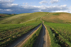 Dirt Road Leading On Top Of The Hill Royalty Free Stock Photo
