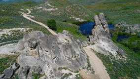 Dirt road leads through to rock formations stock video footage