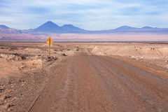 A dirt road leads to the Volcano Licancabur in San Royalty Free Stock Images