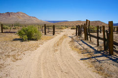 Dirt Road Leads into Wooden Corral Royalty Free Stock Photography
