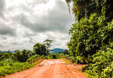 Dirt road in Liberia. West Africa. Sodden after the rain the dirt road through the jungle in Liberia Royalty Free Stock Photo