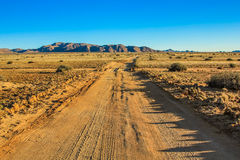 Dirt road in the middle of the desert in Namibia Stock Photography