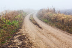 Dirt road in mist Royalty Free Stock Photography