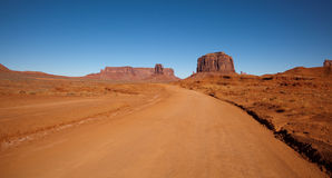 Dirt Road Through Monument Valley Royalty Free Stock Photography