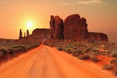 Dirt road in Monument Valley Tribal Park, Utah, USA. Dirt road under a hot desert sun in Monument Valley Tribal Park, Utah, USA royalty free stock images