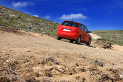 Dirt road on a mountain slope. Stock Photos