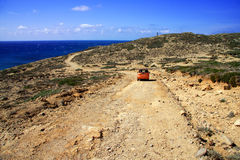 Dirt road on a mountain slope. Greece. Rhodes Stock Image