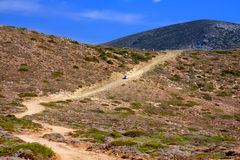 Dirt road on a mountain slope.Landscape in a sunny Stock Photography