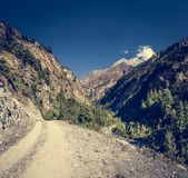 Dirt road through a mountain valley. Royalty Free Stock Images