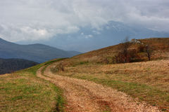 The dirt road in mountains of Crimea Royalty Free Stock Images