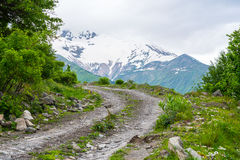Dirt road in the mountains in Georgia Royalty Free Stock Photo