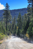 Dirt Road in the Mountains Stock Photos