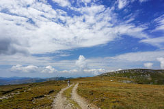 Dirt road in the mountains Royalty Free Stock Photos