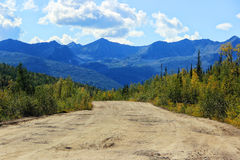 Dirt road and mountains in Siberia Royalty Free Stock Photo