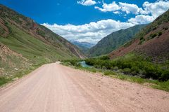 Dirt road in mountains Royalty Free Stock Image