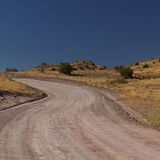 Dirt Road New Mexico. Dirt road in the State of New Mexico under blue sky Royalty Free Stock Photo