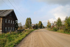 Dirt road in northern Russian village Royalty Free Stock Photos