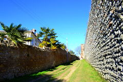 Dirt road by old fortress wall Stock Images