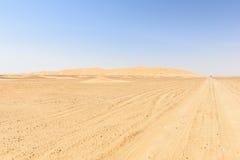 Dirt road in Oman desert (Oman) Royalty Free Stock Image