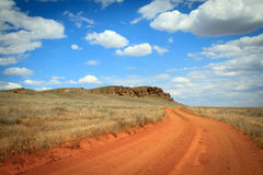 Dirt road orange prairie, going to the sky Stock Image