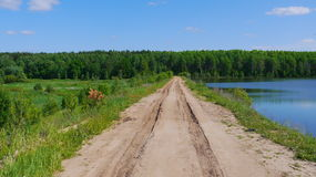 Dirt road over dam Royalty Free Stock Images
