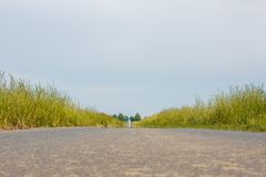 Dirt road with paved road royalty free stock photography