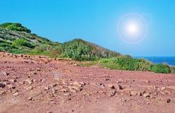 Dirt road in Porticciolo. Red dirt road in Porticciolo, Alghero Stock Image