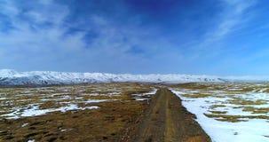 Dirt road on Qinghai-Tibetan Plateau. Aerial 4k footage. stock video footage