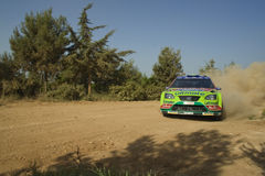Dirt road race car. Race car speeding over dirt road Royalty Free Stock Images
