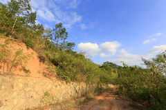 Dirt road and retaining wall of dapingshan mountain Stock Photos