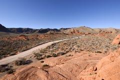 Dirt road in rocky desert Royalty Free Stock Image