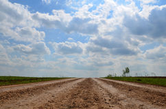 Dirt road in Russia a clear sunny morning. In the village Royalty Free Stock Images