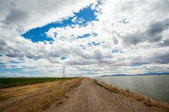 Dirt road and Salt Lake in Utah Stock Photography