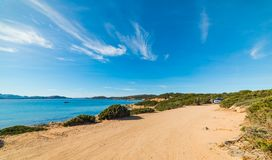 Dirt road by the sea in Caprera island. Sardinia Royalty Free Stock Images