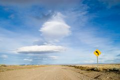 Dirt road with sign. Route 40 in patagonia royalty free stock photo