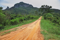 Dirt road on small rocky island Stock Photos
