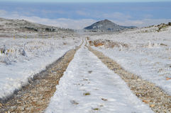 Dirt Road in a Snowy High Mountain Plateau Stock Photography