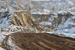 Dirt Road in Snowy Landscape / Quarry royalty free stock image