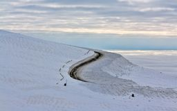 Dirt road in the snowy mountains Royalty Free Stock Photo