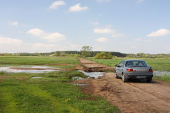 Dirt road spring broken by flood. Stopover Royalty Free Stock Photo
