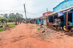 Dirt road with stores and houses in Bukoba, Tanzania Stock Photo