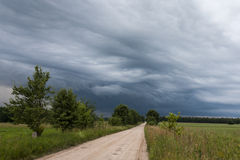 Dirt road and storm. Royalty Free Stock Photography