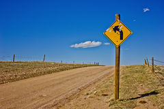 Dirt Road Street Sign with Bullet Holes Royalty Free Stock Images