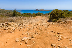 The dirt road strewn with large stones. Royalty Free Stock Images